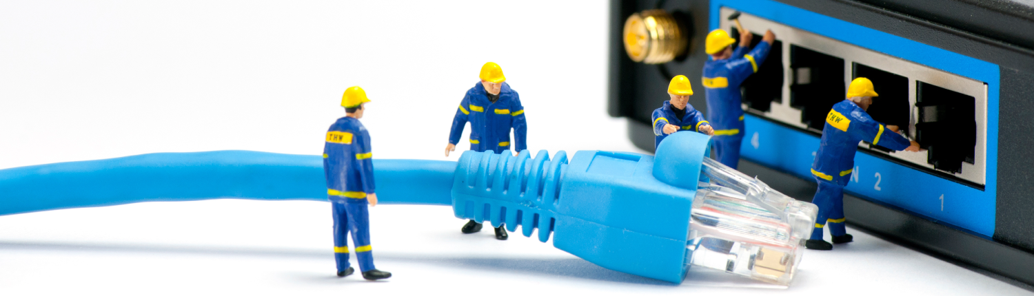 Five toy men trying to insert a cable