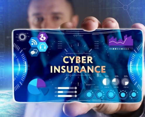 Man holding cyber insurance on a blue dashboard